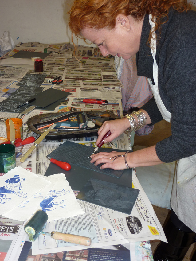 Mary working on a lino print - Lindfield Art Studio