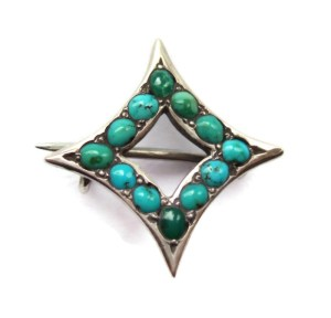 Tiny Edwardian Persian turquoise and silver brooch.