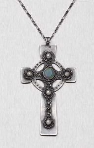 Mary Thew opal and pearl-decorated Celtic cross. No mention in the description if it was signed on the back. Sold in 2006 by Lyon and Turnbull.