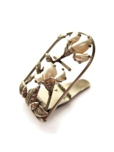 Lotus dress clip, in mother of pearl and white metal.