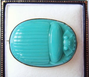 Early Victorian turquoise glass scarab brooch.