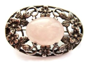 Brooch in the style of Bernard Instone, with rose quartz and silver.