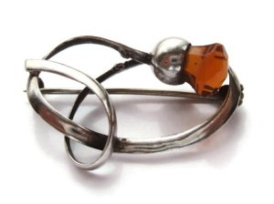 Thistle brooch by Charles Horner, silver and citrine glass.