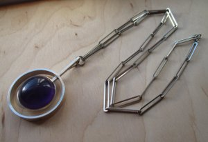 N E From modernist amethyst necklace with paperclip chain.