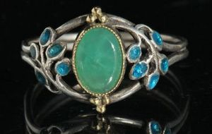 Jessie M. King for Liberty & Co. Ring, gold, silver, enamel and chrysoprase. Sold by Tadema Gallery.