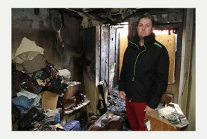 Andrew hamilton-Muspratt, the manager of the Cats Protection charity shop in Gillingham, in the burnt-out shop.