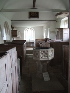 Looking from the west end towards the chancel. The font is a 19th century copy of a 15th century font.