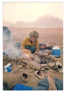 Hannah (or is it Ug the Cavewoman?) cooking on the camel shit fire, wadi Rum , 1985.