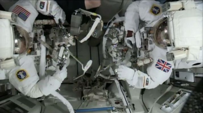 Tm Kopra on the left and Tim Peake on the left. ISSin the background.
