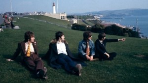 The Beatles on the Hoe in 1967, with Smeaton's Tower in the background.