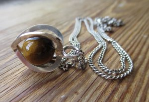 Tiger's eye trapped bead pendant by Elis Kauppi for Kupittaan Kulta. Coming soon to my Etsy shop.