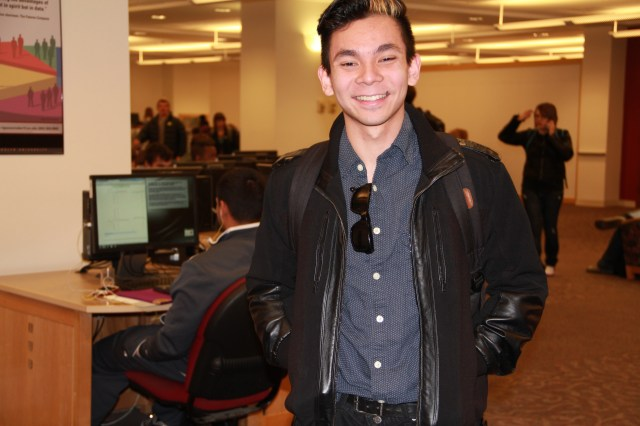 Thinh Nguyen, Creative Advertising Major.  Wearing clothing from Rumors and other thrift stores.