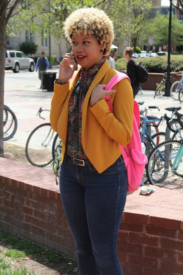 Indica Webb, Philosophy major, wearing a thrifted top, Mine jacket, and Levi jeans.