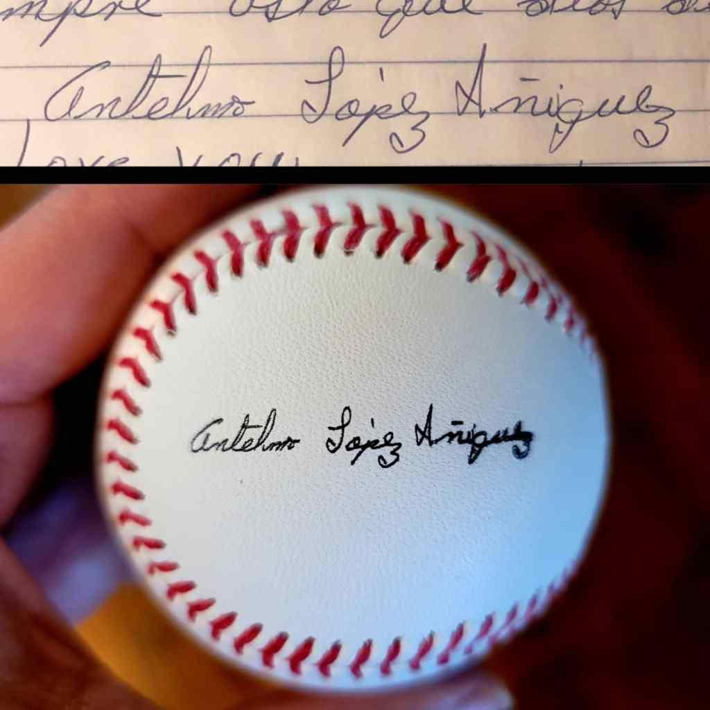 handwritten signature on a baseball