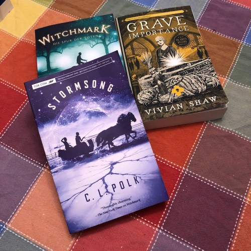 German edition of Witchmark, ARC of Stormsong by CL Polk, Grave Importance by Vivian Shaw