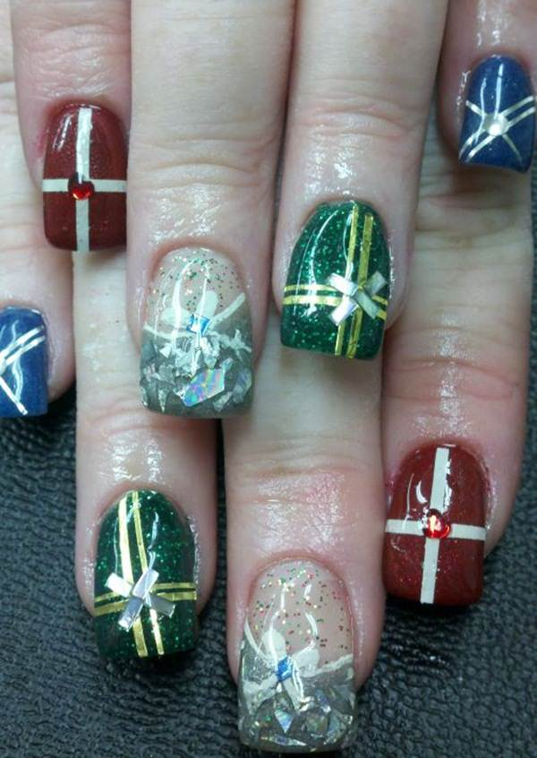Another Accent Nail Art Where Kbe Has Been Painted With A Snowman And The Others Have Adorned Christmas Tree Motif Designs