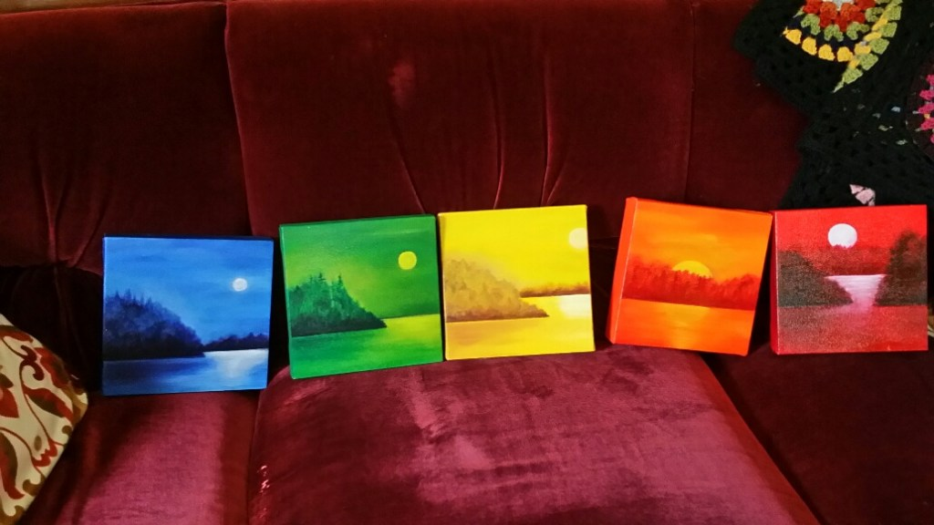 image of a series of painting in the colours of the chakras