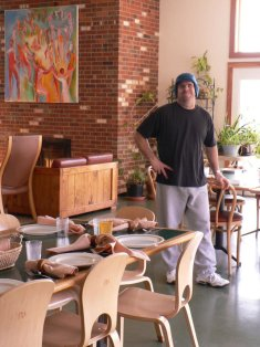 Jon sets tables and makes sure that everyone can enjoy a garden-fresh meal