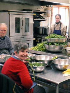 Robert and Linda work together to prepare a meal for the community.
