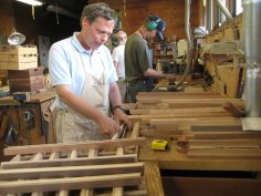 Willie works in the woodshop to create items for sale