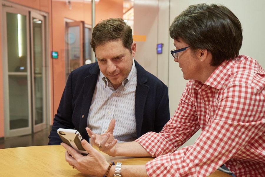 Venture Cafe participants discuss a digital app.