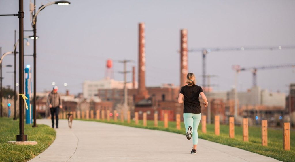 Woman running on the Innovation Quarter's Long Branch Trail