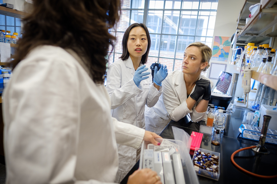 Wake Forest chemistry professor works with graduate students at a lab at Wake Forest University's Downtown campus located in the Innovation Quarter.
