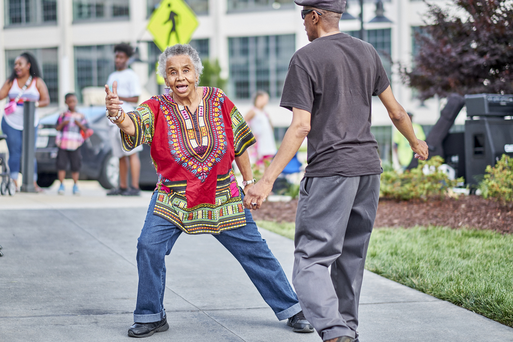 Spectators dancing to music at Juneteenth Festival.