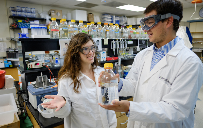 Two young students work in a lab in Winston-Salem's downtown Innovation Quarter.