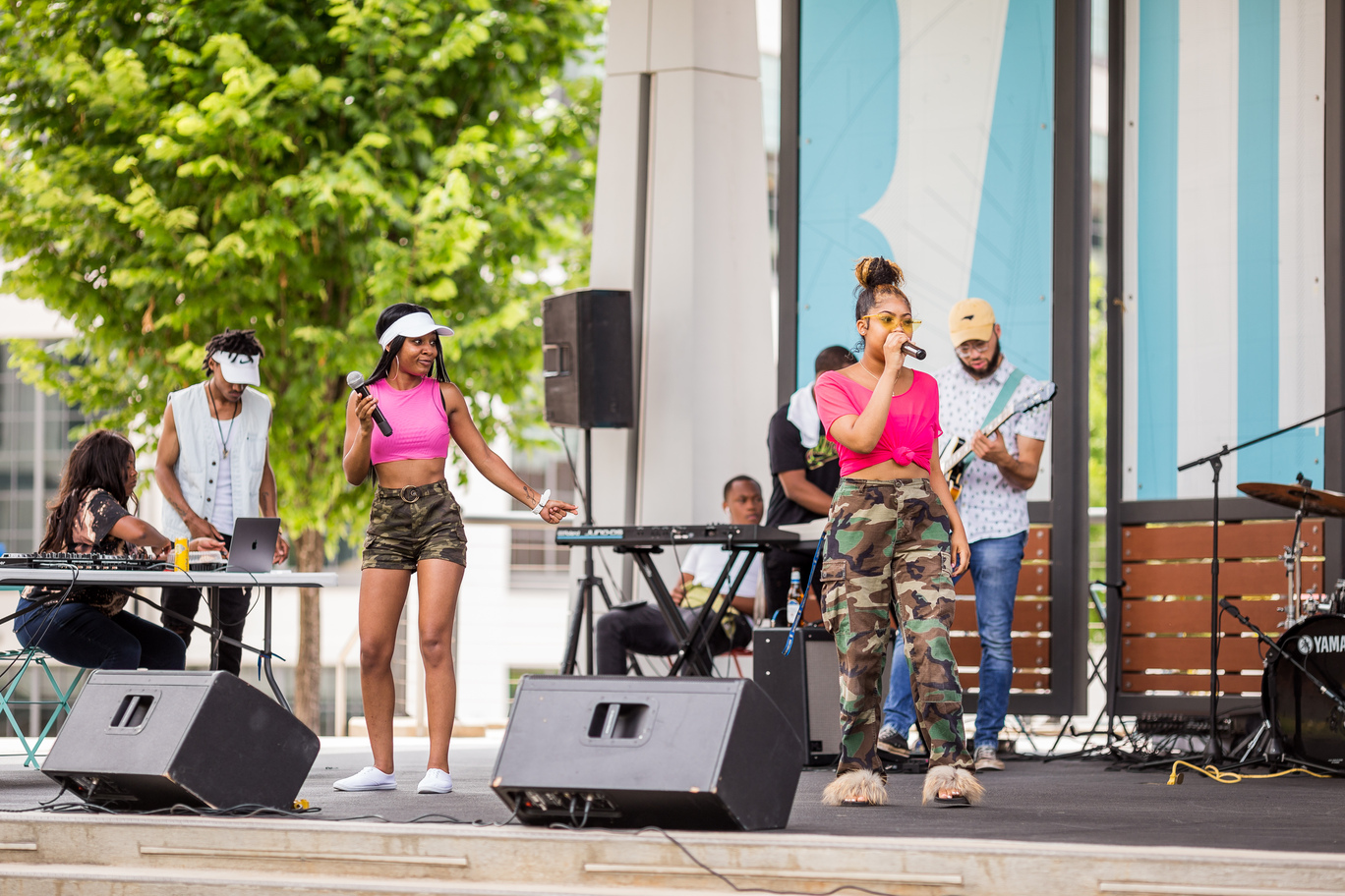 Two women sing music on stage at Bailey Park during Food Truck Friday.