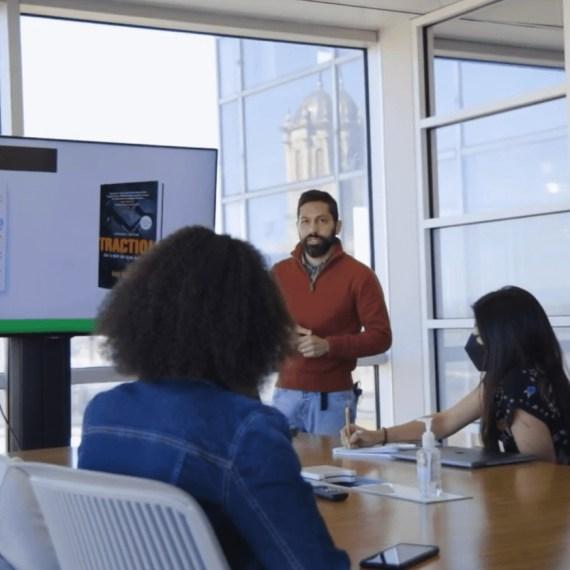 Kasem Rodriguez Mohsen facilitates a meeting.