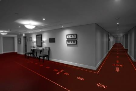 LED light transmissive carpets to provide information, direction, inspiration and safety in offices, hotels and public buildings