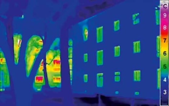 This infrared photo shows heat loss from a normal house on the left, compared to a passive house on the right. Credit: Illustration: Passivhaus Institut