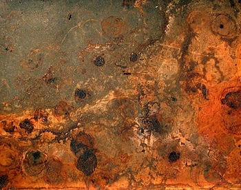 Rust and dirt on a baking plate. Français : Rouille et saleté sur une plaque de four. (Photo credit: Wikipedia)