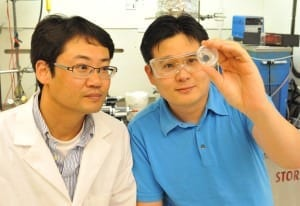 Graduate Student Byeong Wan Kwon (l) and WSU Associate Professor Su Ha inspect a fuel cell.