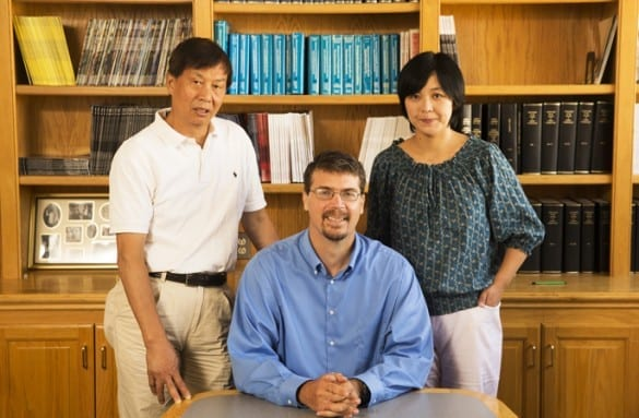 Sean Davies, Ph.D., center, Zhongyi Chen, M.D., Ph.D., left, and Lilu Guo, Ph.D., are studying using bacteria as a therapeutic compound in the gut to counteract the effects of a high-fat diet. (photo by Joe Howell)