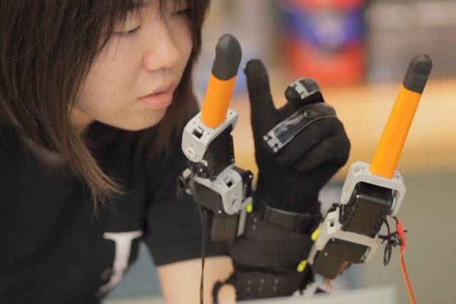 Faye Wu, a graduate student in mechanical engineering, demonstrates the