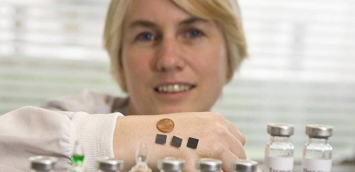 Dr Anne Moore with microneedle patches on her hand Image Tomás Tyner