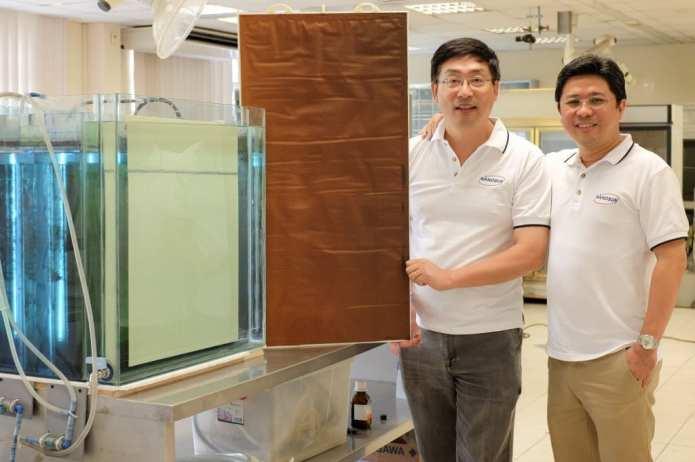 Founder NTU Assoc Prof Darren Sun (left) holding the new Nano Sun membranes, with Managing Director and NTU business professor Wong Ann Chai (right).