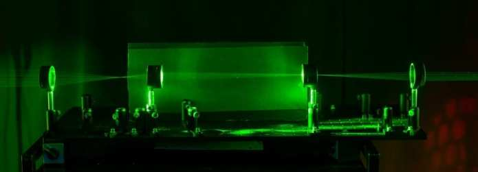 This is a side view. The laser shows the paths that light rays travel through the system, showing regions that can be used for cloaking an object - via University of Rochester