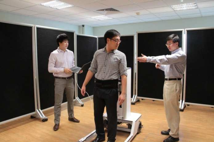 This is the novel robotic walker invented by team of researchers led by assistant professor Yu Haoyong (far right) from the Department of Biomedical Engineering at the National University of Singapore Faculty of Engineering. Credit: National University of Singapore