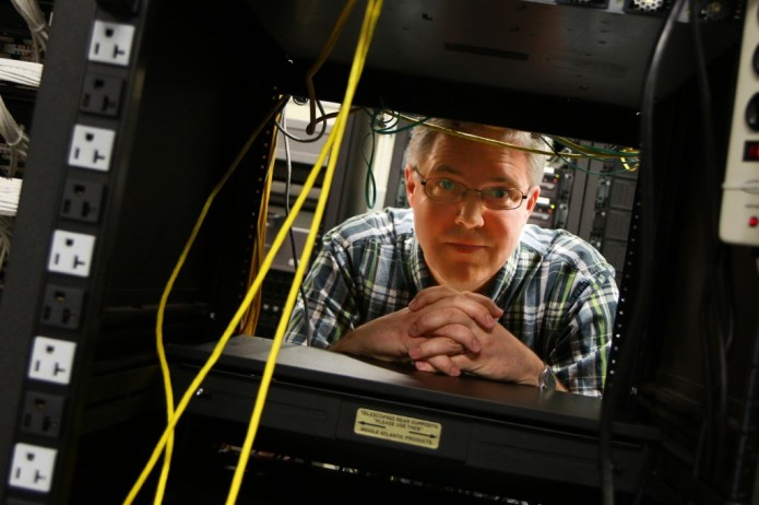 "Eric Eide, University of Utah research assistant professor of computer science, stands in the computer science department's ""Machine Room"" where racks of web servers sit. It is on these computers that Eide, U computer science associate professor John Regehr, and their research team created and tested A3, a suite of computer applications that defeat malware and automatically repair the damage it causes. The project could help lead to better consumer software defenses. Photo Credit: Dan Hixson/University of Utah College of Engineering Photo Credit: Dan Hixson/University of Utah College of Engineering Photo Credit: Dan Hixson/University of Utah College of Engineering Photo Credit: Dan Hixson/University of Utah College of Engineering Photo Credit: Dan Hixson/University of Utah College of Engineering Photo Credit: Dan Hixson/University of Utah College of Engineering Photo Credit: Dan Hixson/University of Utah College of Engineering Photo Credit: Dan Hixson/University of Utah College of Engineering Photo Credit: Dan Hixson/University of Utah College of Engineering Photo Credit: Dan Hixson/University of Utah College of Engineering Photo Credit: Dan Hixson/University of Utah College of Engineering Photo Credit: Dan Hixson/University of Utah College of Engineering Photo Credit: Dan Hixson/University of Utah College of Engineering Photo Credit: Dan Hixson/University of Utah College of Engineering"
