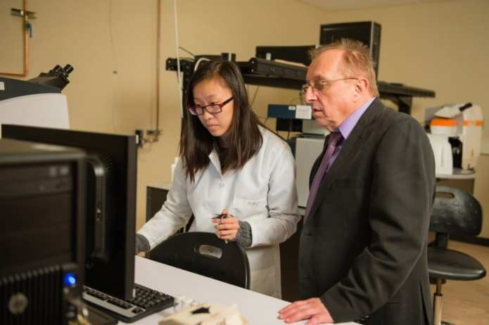 Marek Urban, right, is developing polymers that heal themselves like skin. via Clemson