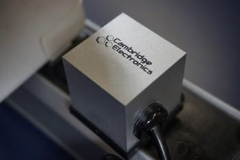 Shown here is a prototype laptop power adapter made by Cambridge Electronics using GaN transistors. At 1.5 cubic inches in diameter, this is the smallest laptop power adapter ever made. Image: Cambridge Electronics