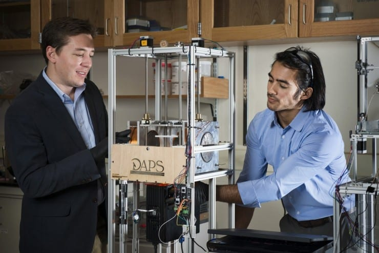 Northeastern assistant professor Randall Erb, left, and Joshua Martin, PhD'17, have developed an innovative 3-D printing technology that could revolutionize important biomedical equipment, enhancing treatment for everyone from premature babies to patients needing implants. Photo by Adam Glanzman/Northeastern University