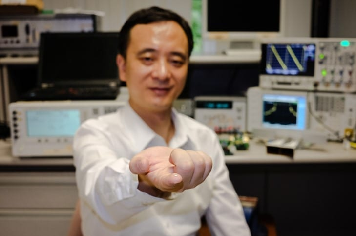 NTU's tiny Radar chip on Asst Prof Zheng Yuanjin's finger