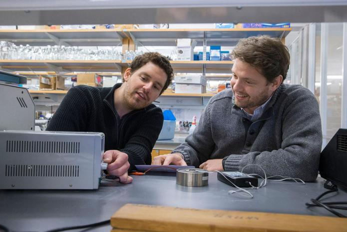 Michael Wheeler, left, and Ali Deniz Güler engineered a synthetic gene that, used in conjunction with a magnetic field, allows them to control neural circuits. (Photo by Dan Addison)