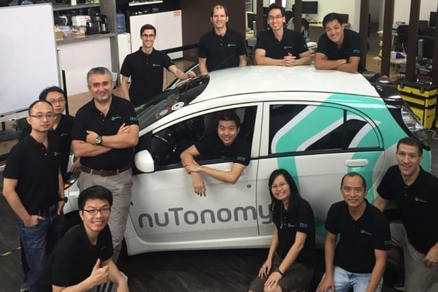 The nuTonomy team, including Emilio Frazzoli (third from left, standing), with one of their driverless cars Courtesy of nuTonomy