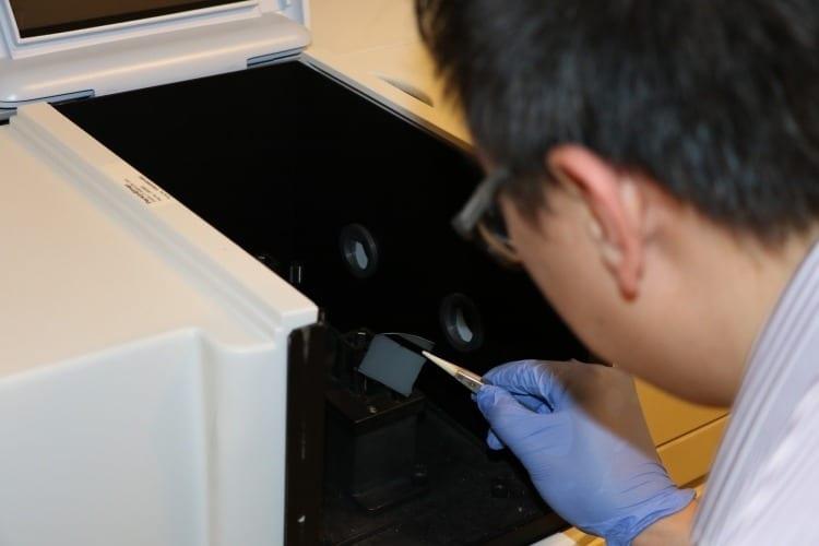 Masdar Institute postdoctoral researcher, Dr. Jin You Lu, characterizes the nanoporous solar absorber with UV-Vis-NIR spectroscopy. Photo: Tahra Al Hammadi, Masdar Institute News