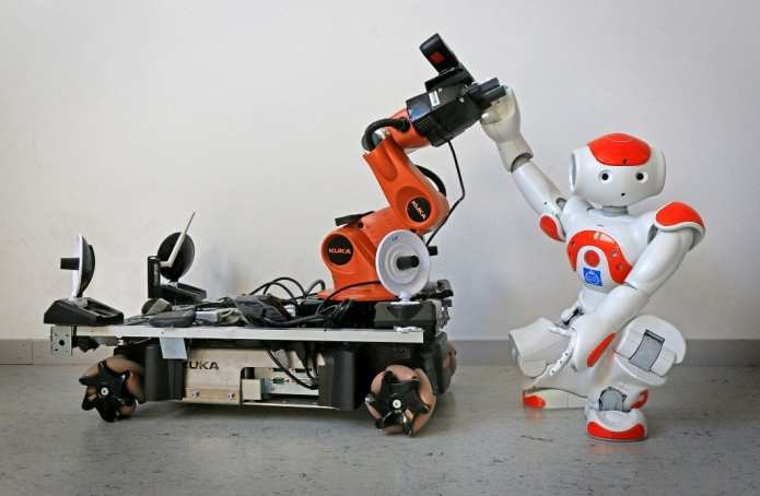 """Two off-the-shelf robots were used to demonstrate how robots can pick up each other's signals for assistance, and even set aside their own tasks in order to lend a """"hand""""."""